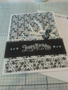 Diamantes for added sparkle - Pale Blue and Aurora Borealis. White heat embossing.
