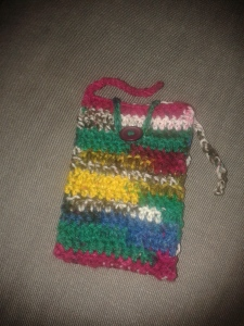 A crochet project with a button closure.