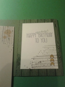 Several layers of stamping tie the inside of the card to the outside. the greeting is also a dual stamping technique.