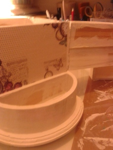 Base coat of gesso plus the beginnings of paper being added.