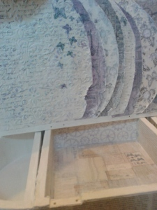 The lid interior: Dry embossed and highlighted with Gesso and Lilac Distress ink.