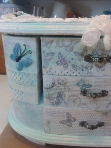 Finished drawers with velveteen butterfly.