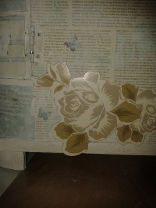Embellishing the rear of my Jewellery Chest - chipboard roses and glass gems.