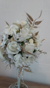 A selection of faux flowers were used within the arrangement.