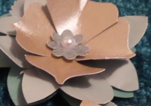'Petals' on the Bracket Label shape, creased and folded into valley folds.