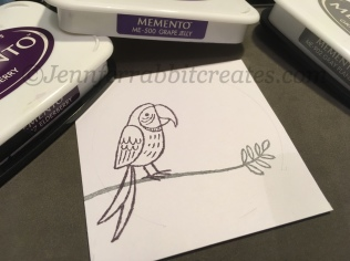 Step 2: I stamped the left Parrot in my chosen Memento Elderberry ink.