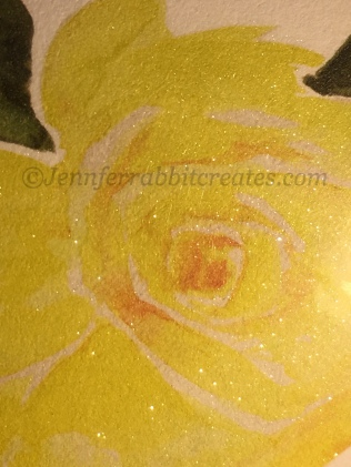 Wink of Stella coated yellow rose.